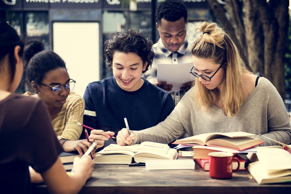 group of students studying around a table