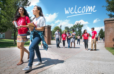 """Picture of CSI students walking on campus with a """"Welcome"""" graphic in the sky"""