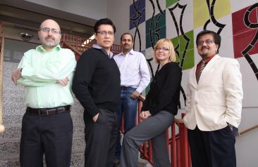 Group of 5 faculty members in building 6S