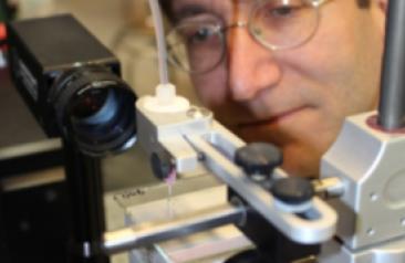 tech incubator man with microscope
