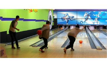 Three students bowling