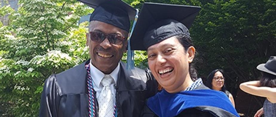 David Jordan with student at commencement