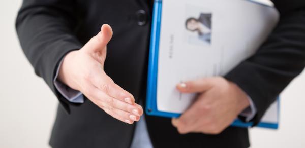 man extending hand for hand shake