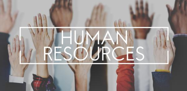 Human Resources signage and hands raised