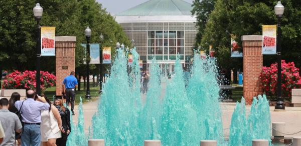 walkway to library with blue water waterfalls