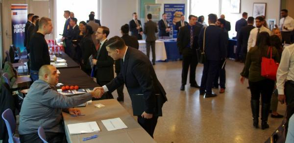 Recruiter and student shaking hands at the annual Accounting Career and Scholarship Fair