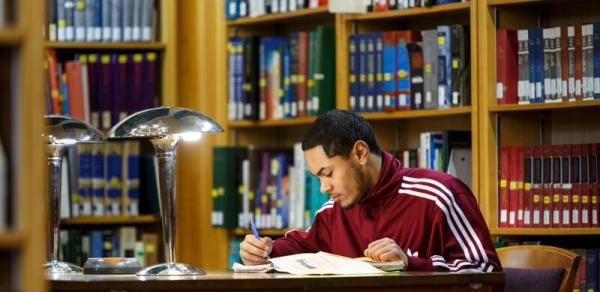 male student in library
