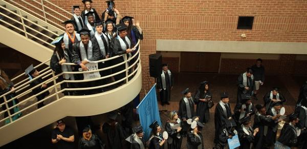 Graduating Students Walking Through The Atrium