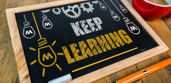 Image of a 'Keep Learning' blackboard