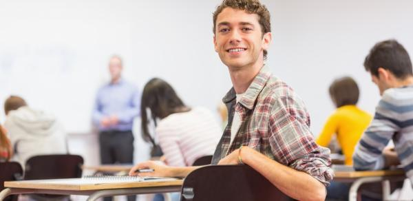 Student smiling in a classroom