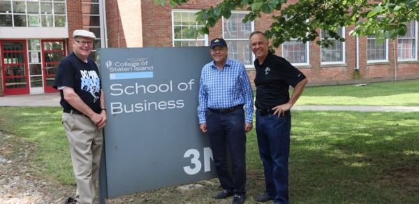 President Fritz in front of School of Business building