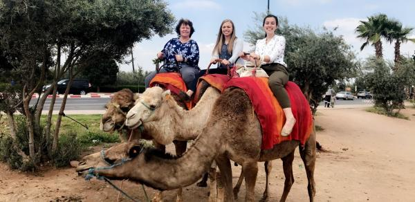 3 women on camels in Morocco