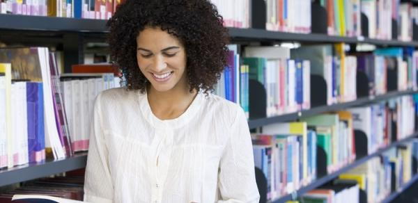 female student with book in library