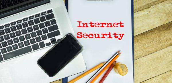laptop keyboard and Internet Security verbiage