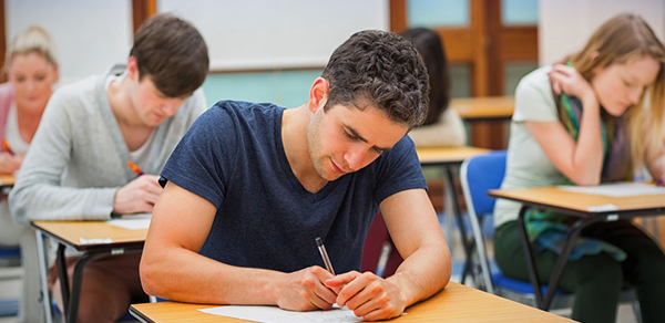 male student taking test