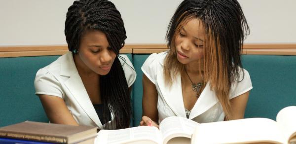 Students Looking Through Workbook