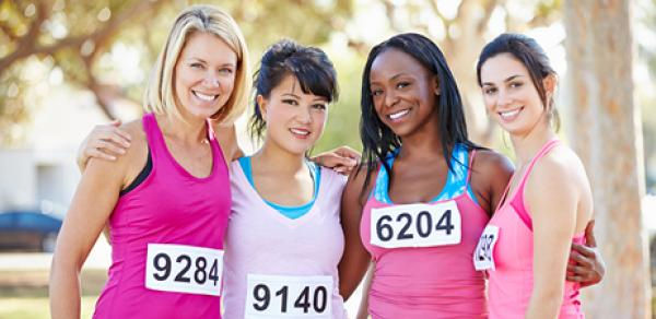 4 women with runner's bibs