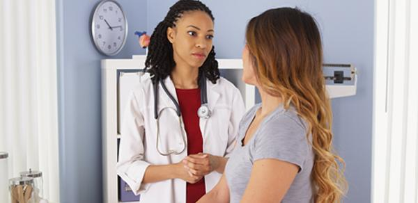 A woman talking to a doctor