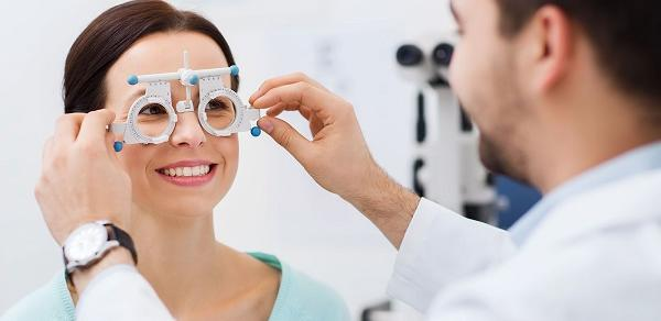 Optician Putting an Optometrist Tool on a Patient