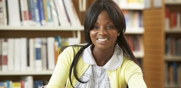 Smiling Student Seated In Library