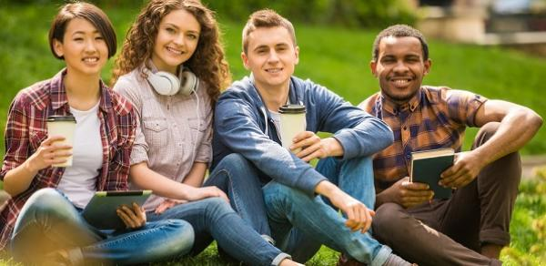 group of students sitting on lawn