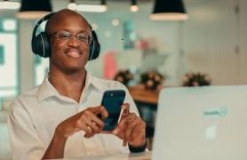 man sitting at laptop creative exchange