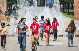 Honors students walking past CSI fountain