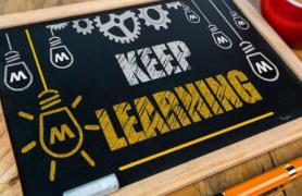 chalk board with keep learning written
