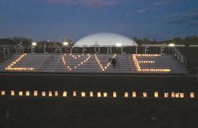 CSI bleachers with candles lit to spell LOVE