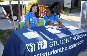 students at table welcoming New Students To Campus