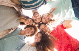 Students In A Circle Facing Down At Camera